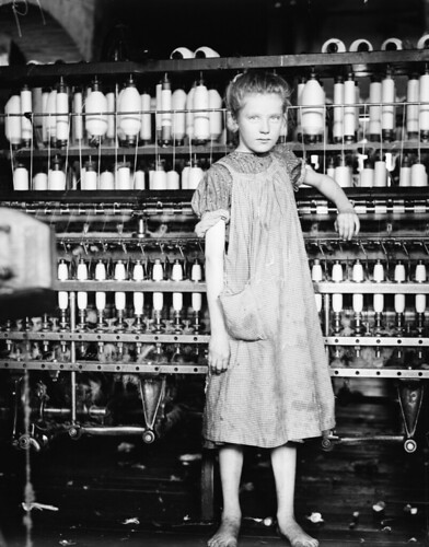 Child Labor:  Barefoot Girl in Factory.