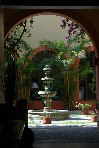 Traditional courtyard, through arches, fountain, plants, flowers, Centro Histórico, historical district, South Mazatlan, Sinaloa, Mexico by Wonderlane