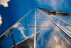 Reaching out to heaven (manganite) Tags: blue windows sky abstract reflection tower texture topf25 glass colors architecture clouds digital buildings germany point geotagged office construction nikon colorful europe bonn day mood pattern post mail tl steel perspective atmosphere sunny bluesky onecolor d200 nikkor dslr vanishing thecolorblue posttower northrhinewestphalia blueribbonwinner flickrsbest 18200mmf3556 utatafeature manganite nikonstunninggallery 25faves ipernity challengeyou challengeyouwinner aplusphoto date:year=2007 photofaceoffwinner geo:lat=5071562 geo:lon=7130655 date:month=september date:day=15 format:ratio=32 stadtgetty2010