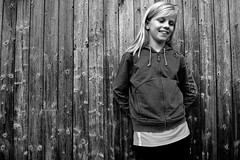 Happy as her (Wen Nag (aliasgrace)) Tags: portrait people blackandwhite bw 15fav girl smile face norway wall female strand rural pose happy person blackwhite kid child young norwegian rogaland ryfylke solbakk