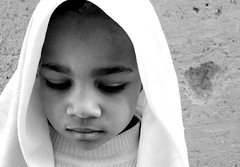 Thoughts....... (Monia Sbreni) Tags: africa portrait bw sepia child noiretblanc zwartwit bn morocco thoughts maroc marocco schwarzweiss marruecos ritratto pensieri pretoebranco zagora bianconero viso marokko biancoenero moroccan marrocos bambina faccia seppia svartvitt blackandwithe espressione  tamegroute abigfave anawesomeshot worldphotodoc2007 moniasbreni ritrattidiof