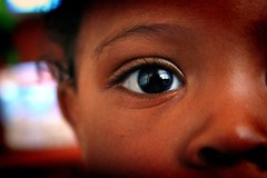 Christian color (ananzi) Tags: boy baby brown color eye eyeball zen stare curious soe curiousity