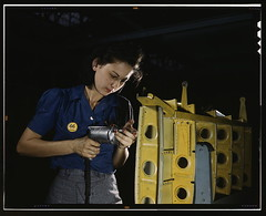 "Drilling horizontal stabilizers: operating a hand drill, this woman worker at Vultee-Nashville is shown working on the horizontal stabilizer for a Vultee ""Vengeance"" dive bomber, Tennessee. The ""Vengeance"" (A-31) was originally designed for the French. It"