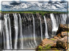 Rainbow falls (HDR) - Victoria Falls (hannes.steyn) Tags: africa nature water lumix fz20 landscapes rainbow scenery group panasonic waterfalls rivers zimbabwe victoriafalls 10000 hdr zambezi naturesfinest blueribbonwinner 3xp flickrsbest perfectangle platinumphoto noti500 anawesomeshot impressedbeauty diamondclassphotographer flickrdiamond photofaceoffwinner hannessteyn elitephotography theperfectphotographer pfosilver goldstaraward flickrhivemind panoramafotogrfico flickrhivemindgroup