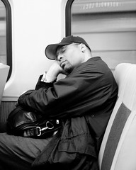 Finally I can take a nap (Life-Show) Tags: life city urban blackandwhite bw man motion blancoynegro philadelphia train bn business commute rest philly adaptation patco speedline snoozing respite