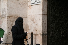 Veil and Sunglasses (hazy jenius) Tags: woman black sunglasses veil muslim islam hijab syria niqab damascus oldcity