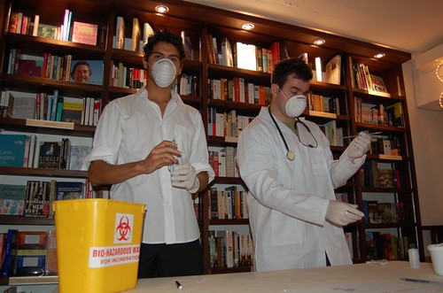 Doctors Peter and Sam prepare to test specimens for signs of infection. Remember the Health Dept cares about you.