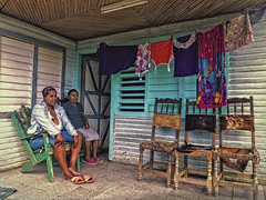 Done with Laundry (Artypixall) Tags: cuba baracoa village porch clotheslines clothes door windows shutters home women sitting portrait ruralscene