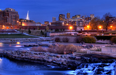 Downtown Denver at Dusk (Thad Roan - Bridgepix) Tags: park bridge building water skyline architecture night buildings river lights waterfall colorado rocks downtown kayak cityscape dusk bridges run denver falls millenniumbridge confluence qwest cherrycreek bridging southplatteriver skyarchitecture bridgepixing bridgepix 200711 conluencepark