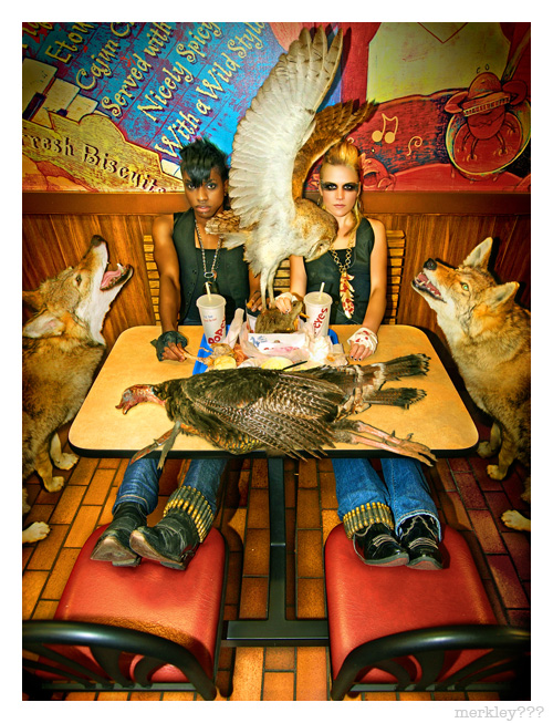 "Dexter & Lauren as Flawk - Feet up Foul & Rodent Dinner at Popeyes With Stabbed Turkey, Rat Thieving Owl and Two Fangy Wolves AKA Flyer Photo For ""When Animals Attack"" Fashion Show May 31st 2008 @ 300 Ritch SF CA"