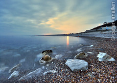 Chesil Cove - Night time long exp (petervanallen) Tags: longexposure light sea seascape beach night portland landscape 1 nikon rocks peace shoreline wideangle pebbles shore serenity chesil sigma1020 d80 1onexplore abigfave anawesomeshot
