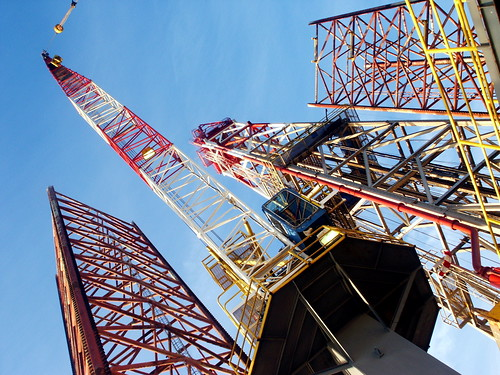 looking up at the towers of a drilling rig