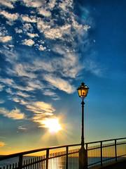 Lightening the clouds (klausthebest) Tags: blue sky italy sun lamp clouds italia nuvole blu liguria cielo soe sori italians lampione nubi themoulinrouge wonderworld blueribbonwinner 50faves flickrsbest passionphotography 25faves golddragon mywinners platinumphoto impressedbeauty aplusphoto onlyyourbestshots holidaysvacanzeurlaub superbmasterpiece diamondclassphotographer superhearts flickrelite theunforgettablepictures platinumheartaward dazzlingshots theperfectphotographer thegardenofzen thegoldendreams tup2