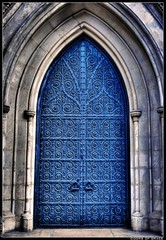 Doors of Grace (OUR WORLD/EXPOSED) Tags: thanksgiving door newyorkcity blue fab church stone canon rebel arch manhattan wroughtiron grace holy doorway rings ornate hdr episcopal handles 2007 apse xti
