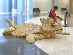 Short-Horned Toad Tamer (catface3) Tags: boy sculpture art giant airport lasvegas gilamonster ih maclaran catface3