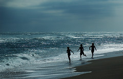 Freedom In The Surf (lynne bernay-roman) Tags: ocean light sea beach children dawn surf florida free running jupiter kidsrunning supershot mywinners