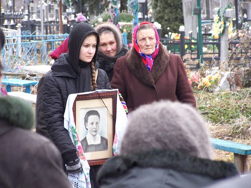 Nastia holding a portrait of Baba Hanya