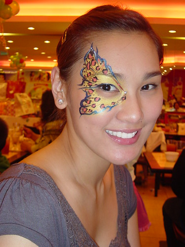 Beautiful Asian girl with lower back Temporary tattoo, leopard butterfly