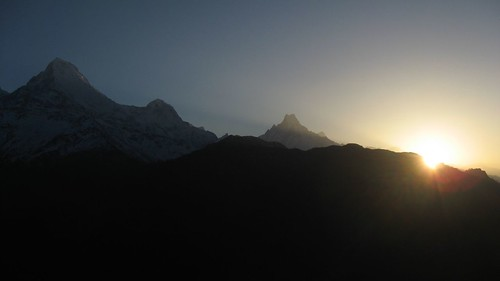The sun illuminates Machhapuchhre, Hiun Chuli and Annapurna South