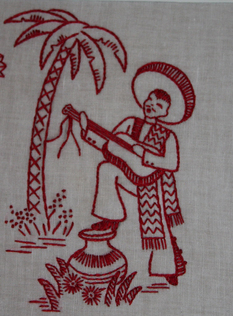 Finished mexicana redwork for mom, man singing with a guitar