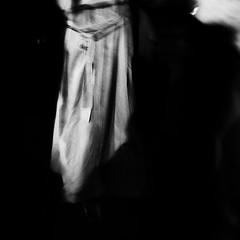 the exit (Nassia Kapa) Tags: dark night leave woman coat bw london fuji fujifilm nassiakapa