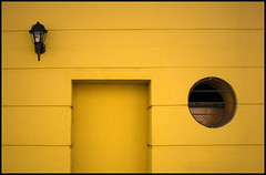 Sour yellow sounds... (psycho ry) Tags: door window yellow wall ventana pared puerta amarillo thecure pornography farol palermo breathtaking