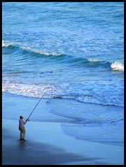Fishing Hope ( AnA oMeLeTe ) Tags: blue sea portugal against azul mar fishing fisherman europe alone terrorism strong algarve pesca enough albufeira praiadarocha sozinho anaomelete april2007 fujifilmfinepixs5600 superbmasterpiece abril2007 1on1photooftheweek 1on1photooftheweekjanuary2008