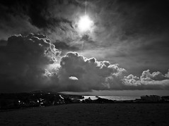 April showers -  Freshwater Bay (s0ulsurfing) Tags: ocean light shadow sea sky blackandwhite bw cliff cloud sunlight white seascape black nature water weather silhouette clouds contrast wow island grey mono bay coast mar interesting skies natural bright wind wide silhouettes dramatic wideangle monotone cliffs explore coastal vectis isleofwight flare april coastline showers drama 2008 powerful isle channel englishchannel wight cirrus freshwater stratocumulus lamanche westwight 10mm freshwaterbay sigma1020 s0ulsurfing fivestarsgallery superbmasterpiece bwartaward