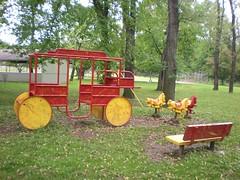 Stagecoach (neshachan) Tags: park playground bench chester wv westvirginia parkbench stagecoach horsies playpark wva vintageplayground playgroundfurniture chesterwv rideonanimals