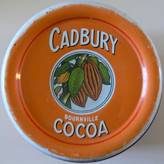 cocoa tin (Foot Slogger) Tags: orange geometric home almostsquaredcircle