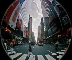 clouds over seventh avenue (sandcastlematt) Tags: street nyc newyorkcity film clouds lomo skyscrapers manhattan toycamera fisheye billboards gothamist advertisements seventhave 42ndstreet seventhavenue lomofisheye fisheye2 lomofisheye2