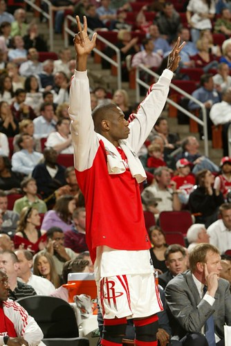 Houston's Dikembe Mutombo celebrates during a great play in the Rockets-Pacers game which Houston won 117-99 for their 16th straight victory, breaking a 14-year old franchise record.  Dikembe wasn't needed much in the victory where 5 Rocket players scored in double figures.