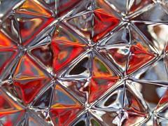 Crystal detail (Mukumbura) Tags: red orange flower detail macro glass crystal tulip decanter