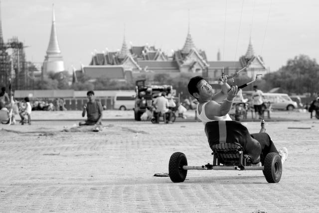 Kite Flying Thai Man in Bangkok in Wheelchair