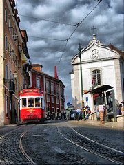 Alfama Tram, Lisbon (photphobia) Tags: red portugal church interesting cloudy lisboa lisbon perspective tram overcast busstop cobbles alfama fiveflickrfavs ilustrarportugal srieouro ~wevegotthepower~ photphobia
