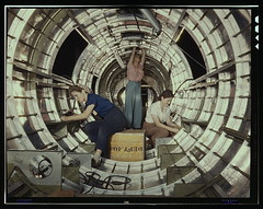 "Women workers install fixtures and assemblies to a tail fuselage section of a B-17 bomber at the Douglas Aircraft Company plant, Long Beach, Calif. Better known as the ""Flying Fortress,"" the B-17F is a later model of the B-17, which distinguished itself i (The Library of Congress) Tags: white silver mediumformat workers construction women october circles rosietheriveter aircraft wwii workinprogress slidefilm symmetry b17 worldwarii longbeach 1940s transparency ww2 4x5 lf libraryofcongress 1942 build flyingfortress largeformat concentric longbeachca worldwar2 cooperation teamwork wartime snood transparencies assembling calfornia manufacturing vintagehair historicalphotographs fusilage b17flyingfortress b17f roind femaleworkers xmlns:dc=httppurlorgdcelements11 douglasaircraftcompany october1942 dc:identifier=httphdllocgovlocpnpfsac1a35337 aircraftmanufacturing alfredtpalmer alfredpalmer cylimder"