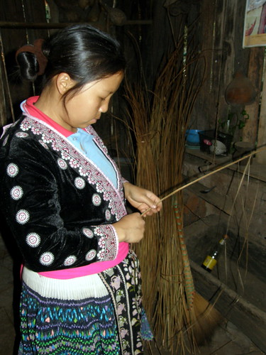 Hmong tribe member weaving hemp