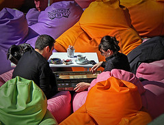 Lazy  Sunday afternoon - backgammon (aistora) Tags: park leica pink boy orange woman man black game color colour green coffee colors girl turkey relax lumix colours afternoon play purple zoom tea candid sunday violet cellphone sunny istanbul panasonic sofa telephoto lilac spy marlboro romantic