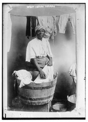 West Indian woman  (LOC) (The Library of Congress) Tags: bucket barrel line clothes wash laundry africanamerican libraryofcongress westindian washday westindies xmlns:dc=httppurlorgdcelements11 dc:identifier=httphdllocgovlocpnpggbain10915 westindianwoman clothrsl notafricanamerican