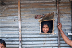 Window - Chittagong, Bangladesh (Maciej Dakowicz) Tags: city travel people eye tourism window girl smile composition children kid asia hand arm bengal bangladesh slum slums chittagong fds24h