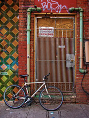 born on jack kerouac alley (shapeshift) Tags: alley architecture bicycle bike born brick california chinatown concrete door doorway electrical gate mailbox metal northbeach pipes plumbing sf textures tiles usa wire jackkerouac graffiti sonydsch1 dsch1 sony sanfrancisco davidpham shapeshift davidphamsf bicycles shapeshiftnet documentary