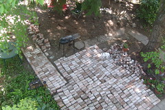 All the brick from under the porch (pieisexactlythree) Tags: home yard garden weeds blackberry ivy patio