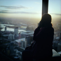 Deep Calls To Deep (memetic) Tags: city sunset sky 120 6x6 window glass clouds mediumformat observation call fuji phone view tl rear melbourne deck figure vista pro eureka pentaconsix ruckenfigur 800z rckenfigur