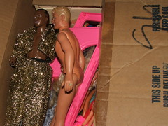 Hammer and Joey McIntyre on top of the box of other barbies.