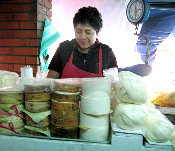 Oaxacan Woman selling Cheeses