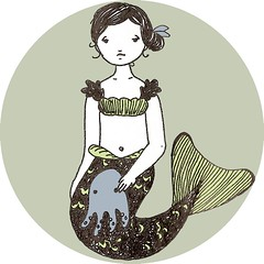 a little mermaid with octopus doll