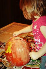 Painting her pumpkin