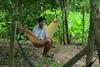 Swing! (Rainedom) Tags: sunset sky people colors fruits animals canon children fun boat coconut rich culture vietnam swamp rides hcmc mekongriver vungtao 400d rainedom rainescape