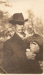 old photo card - postcard - man holding cat (Lynn (Gracie's mom)) Tags: cat vintage antique boutique apb oldphoto holdingcat realphoto apboutique