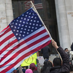 Holding the American Flag at the Wilson Building, A Day Without Immigrants thumbnail